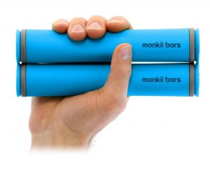 Monkii Bars portable fitness gear held in a hand