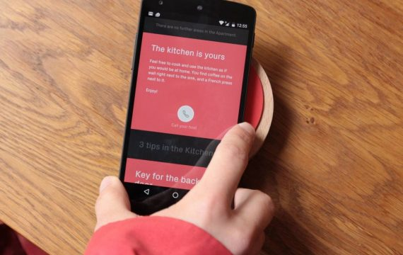 a renter getting a tour from their Airbnb hosts via the Ping device
