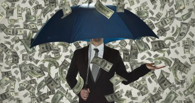 money raining on umbrella representing billion-dollar startups