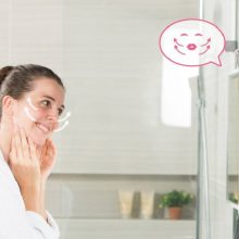 woman using HiMirror smart mirror for skincare