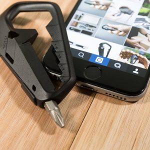 Tactica Talon 17 in 1 tool shown to smartphone