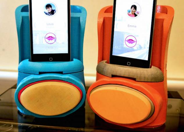 To Send Kisses From Afar, Kissenger Mixed An App With A Fake-Lips-Phone-Dock